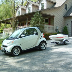 Smart With Trailer At Lake.